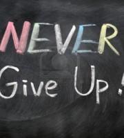 11939322-never-give-up-written-in-chalk-on-a-blackboard
